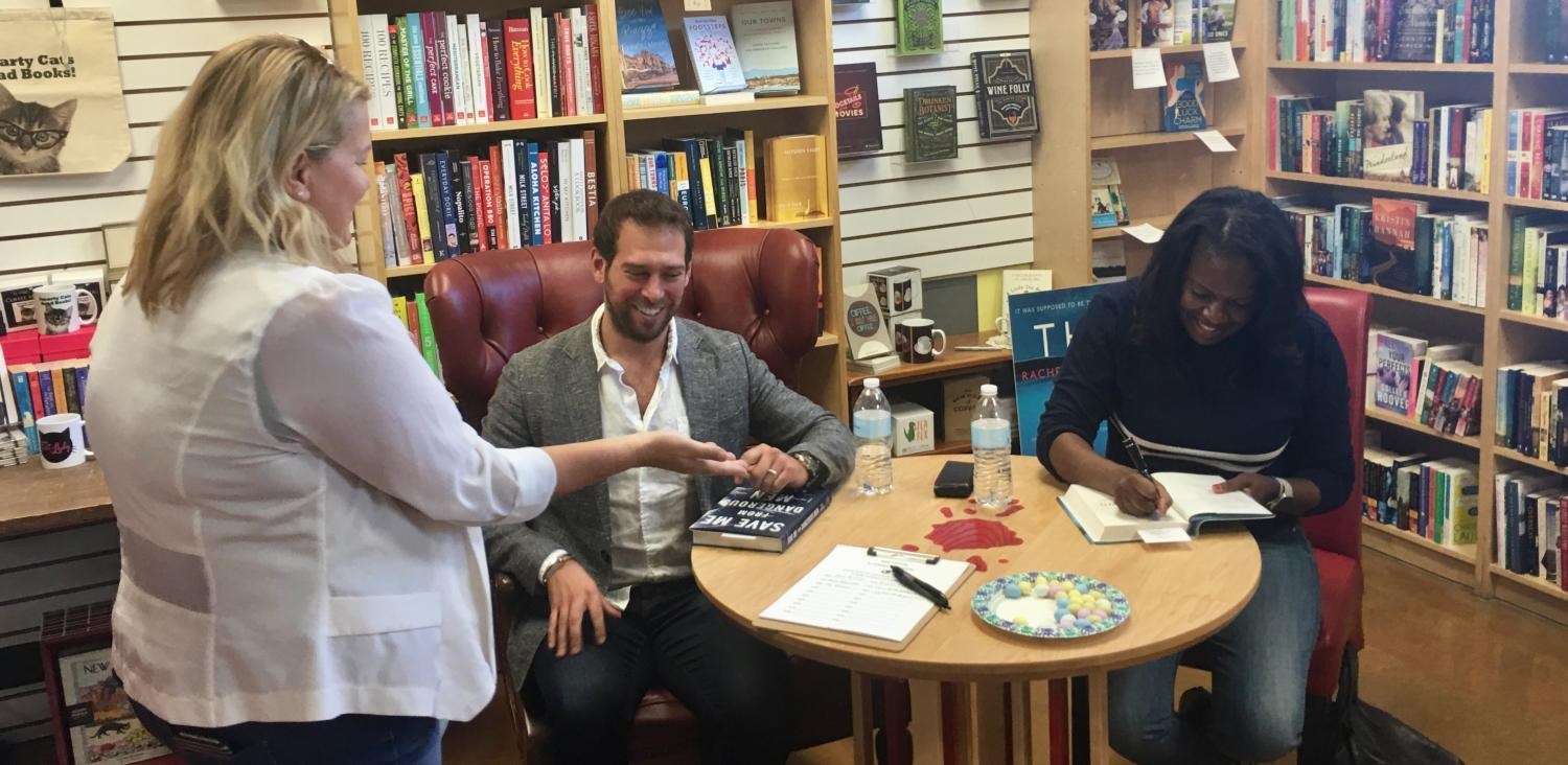 authors signing books at a table