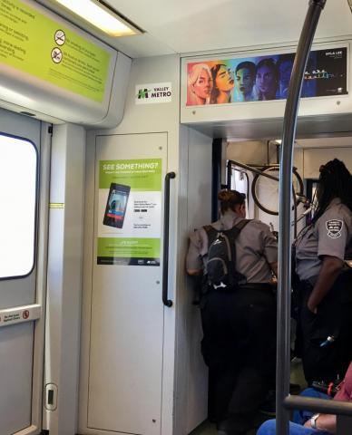 transit security officers standing on train