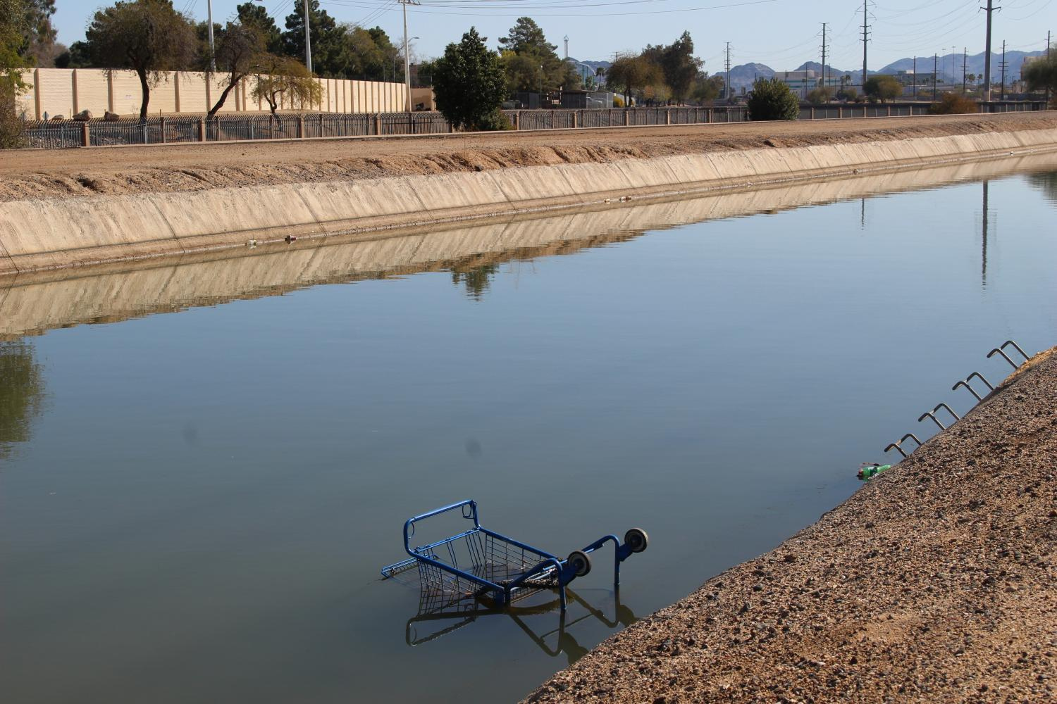 A shopping cart in the SRP Canal bordering Cortez Park in Phoenix.