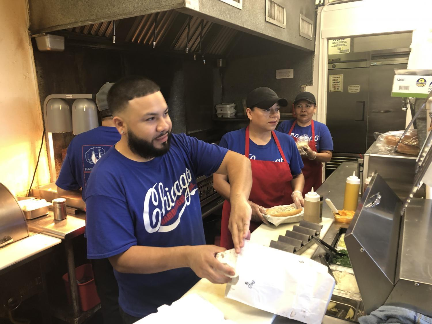 restaurant employees filling orders at counter