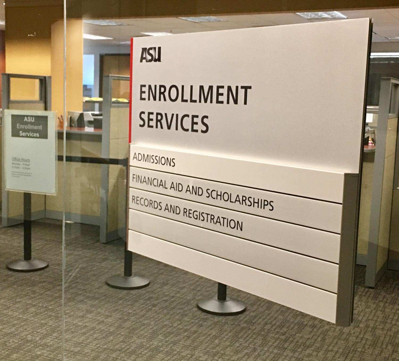 sign on door reads enrollment services