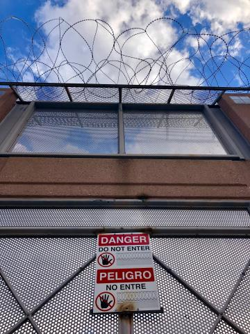 Concertina wire on top of the U.S. fence at the border with Mexico in Nogales