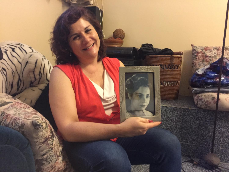 Reyna Osuna with a photo of her mom