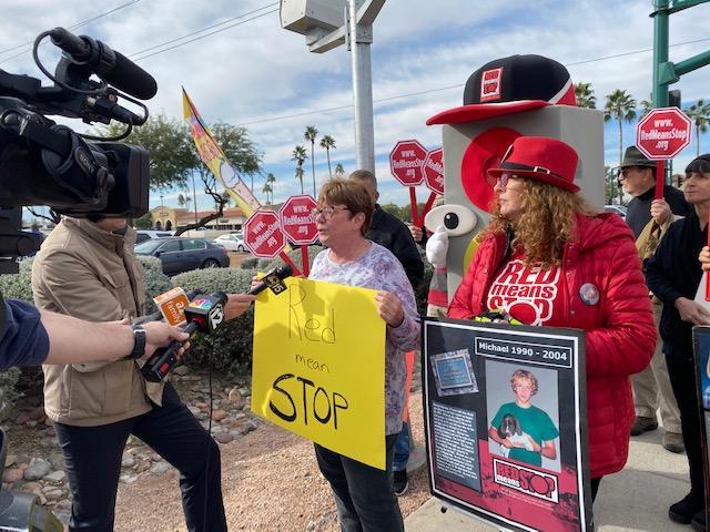 Councilwoman Debra Stark and community members protest the deactivation of Phoenix