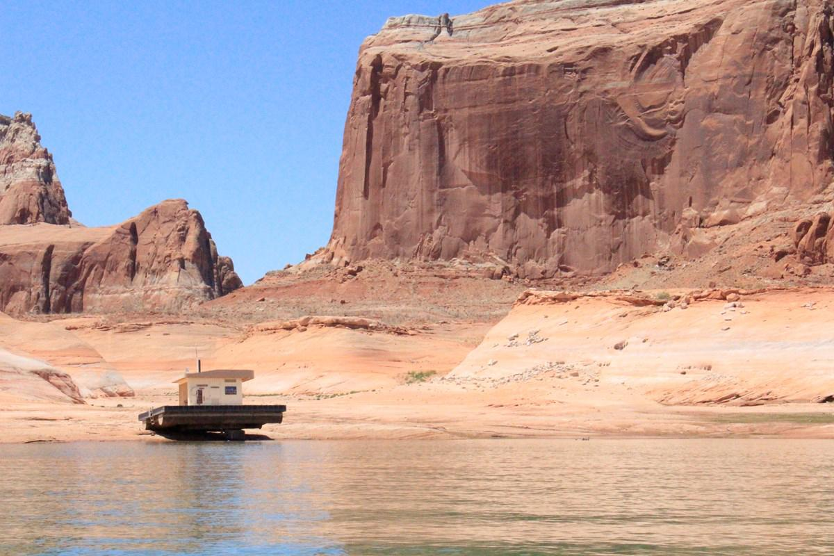 Changing Lake Powell levels left a floating restroom stranded on rock