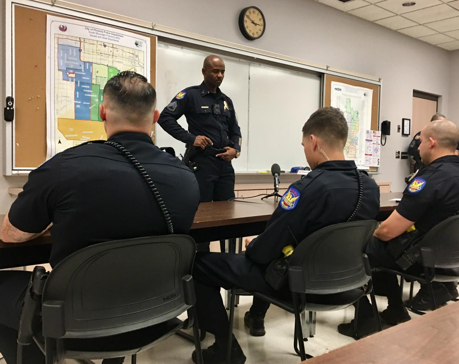 sergeant talking to officers