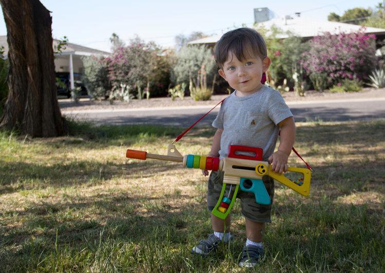 child with a toy gun