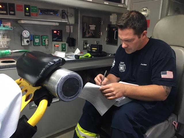 Phoenix Firefighter filling out a form