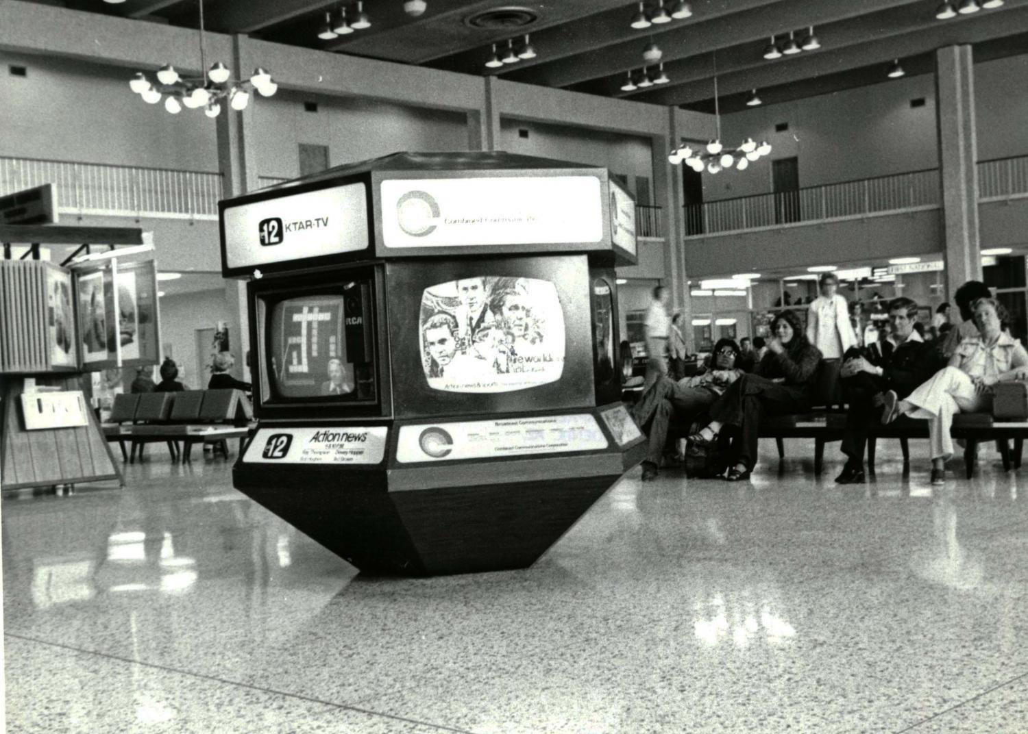 kiosk and people inside terminal