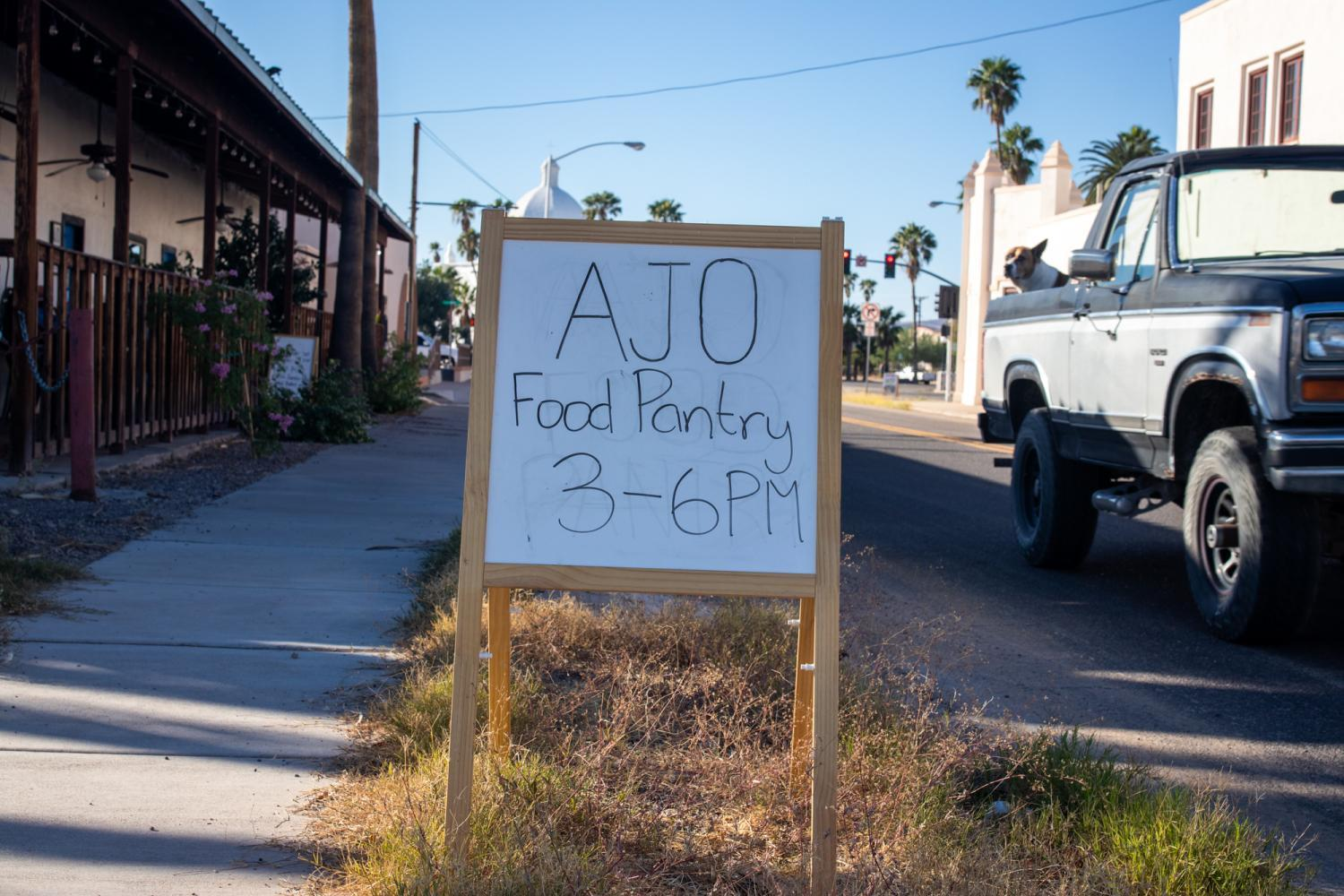 A sign stands in front of the Ajo Farmers Market & Cafe