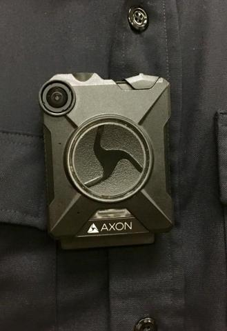 close up of body worn camera on officer