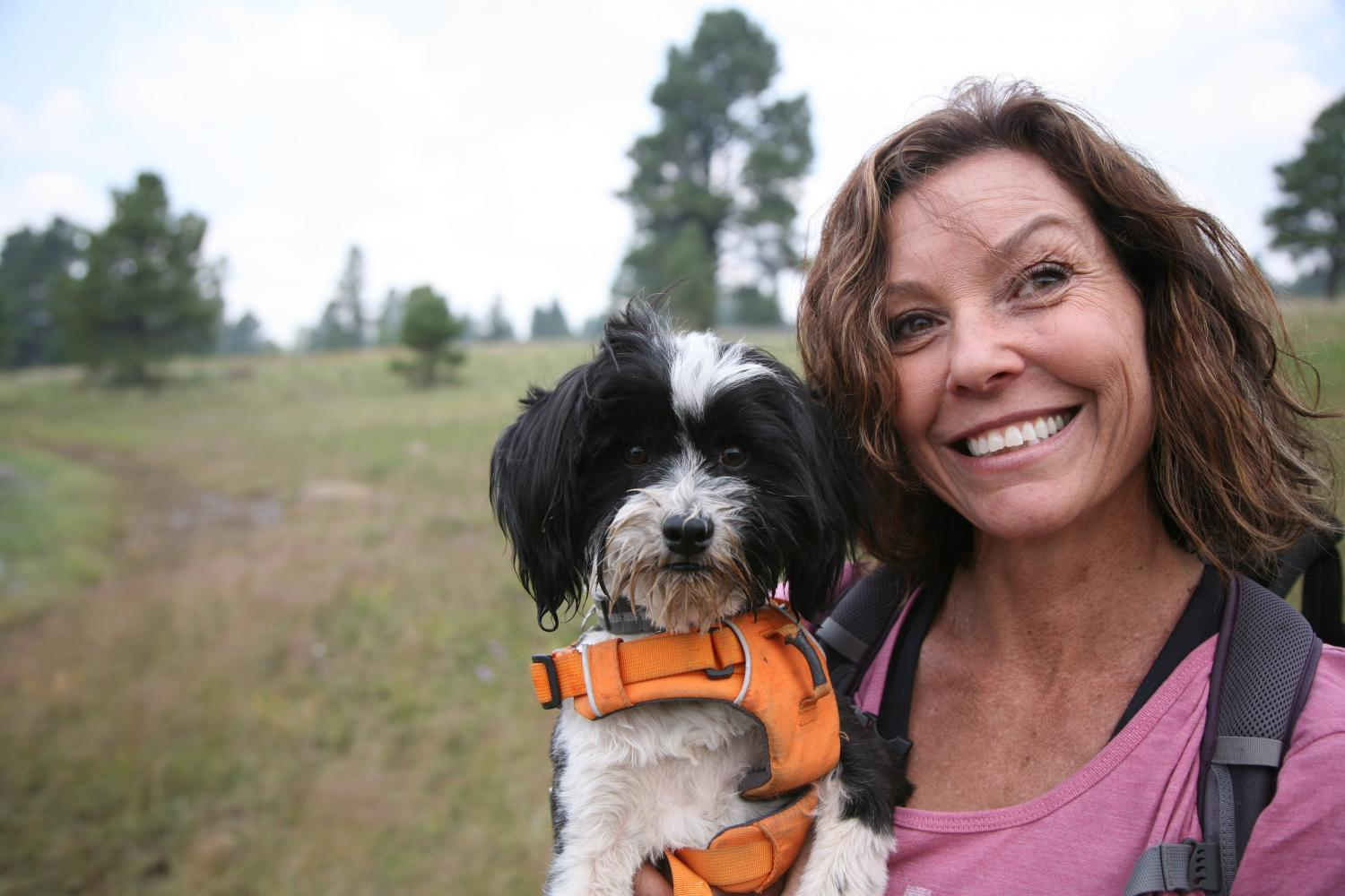 abby  joseph smiling with maggie the Tibetan terrier