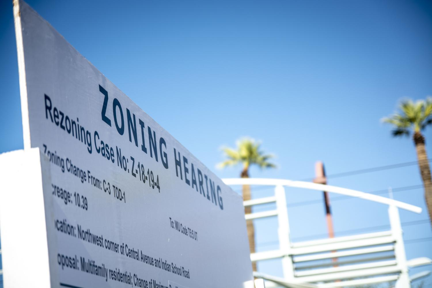 A sign publicizes an upcoming zoning hearing in Phoenix. Affordable housing advocates in cities nationwide are increasingly questioning zoning laws as a factor in housing shortages.