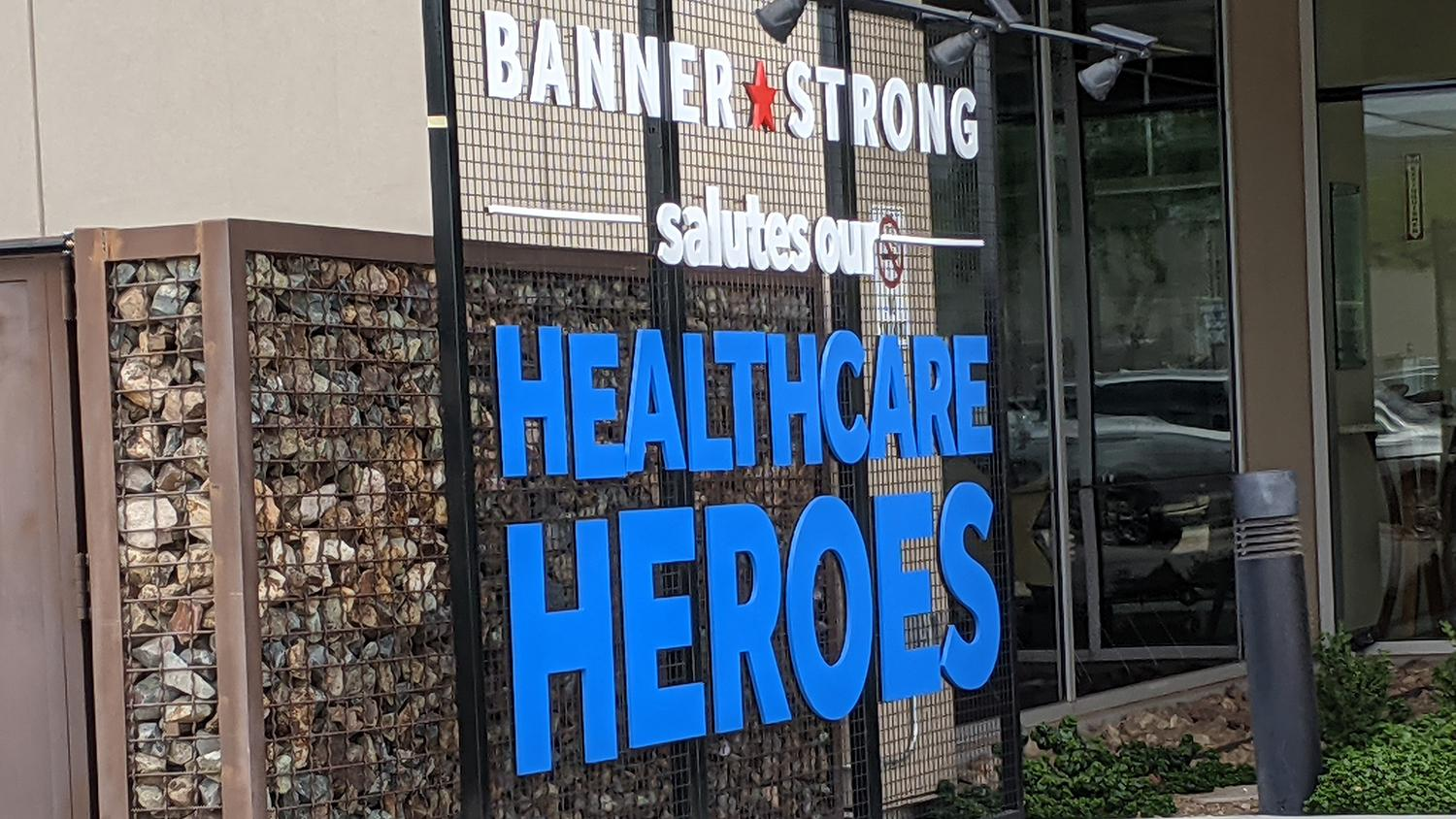A sign honoring health care workers outside Banner Estrella Medical Center