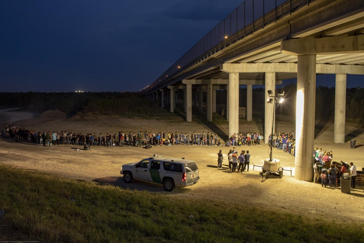 migrants that have crossed the Rio Grande surrender to U.S. Border Patrol