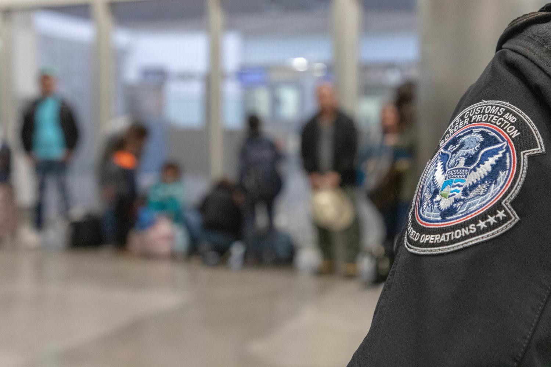 border patrol agent with asylum seekers