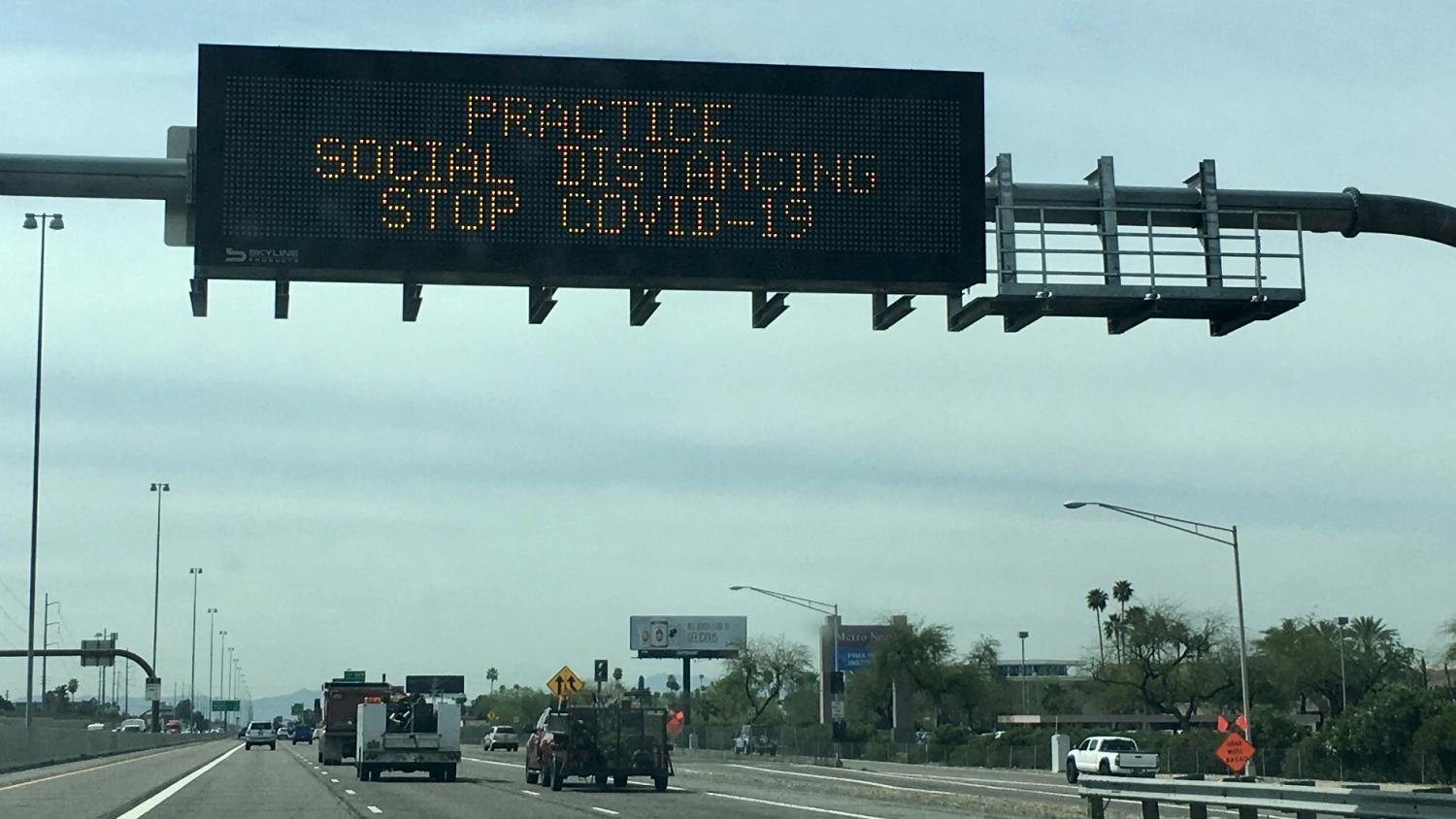 social distancing freeway sign