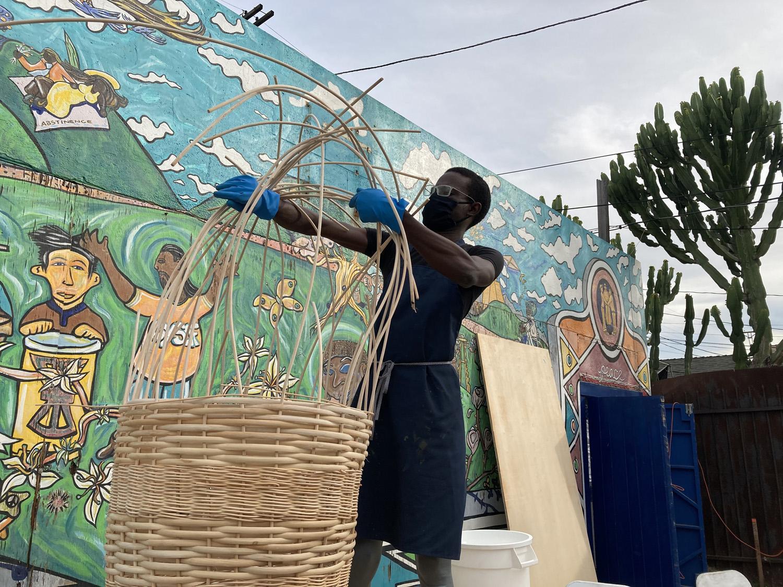 Diedrick Brackens making basket boats