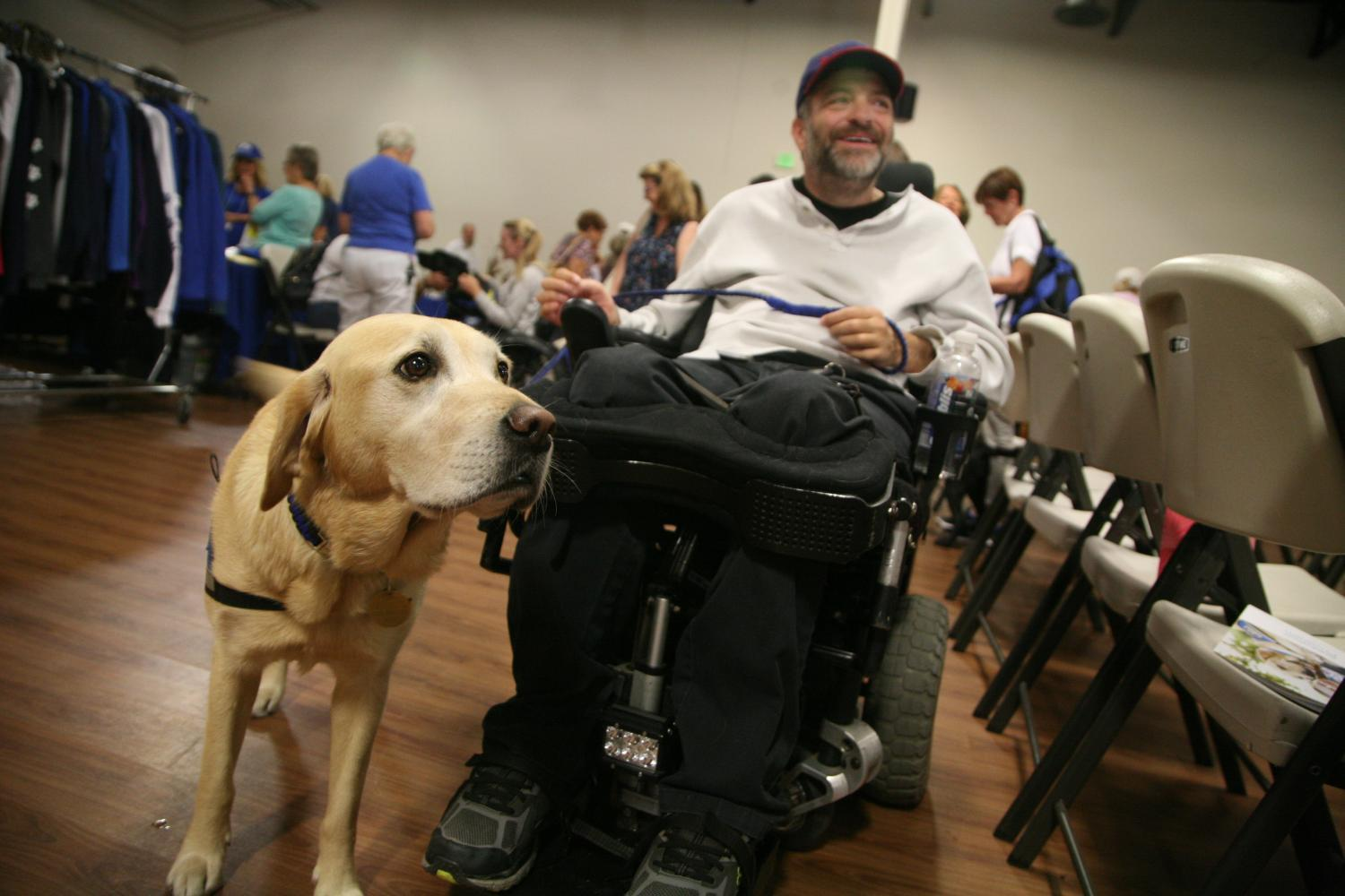 cci dog and owner in a wheelchair