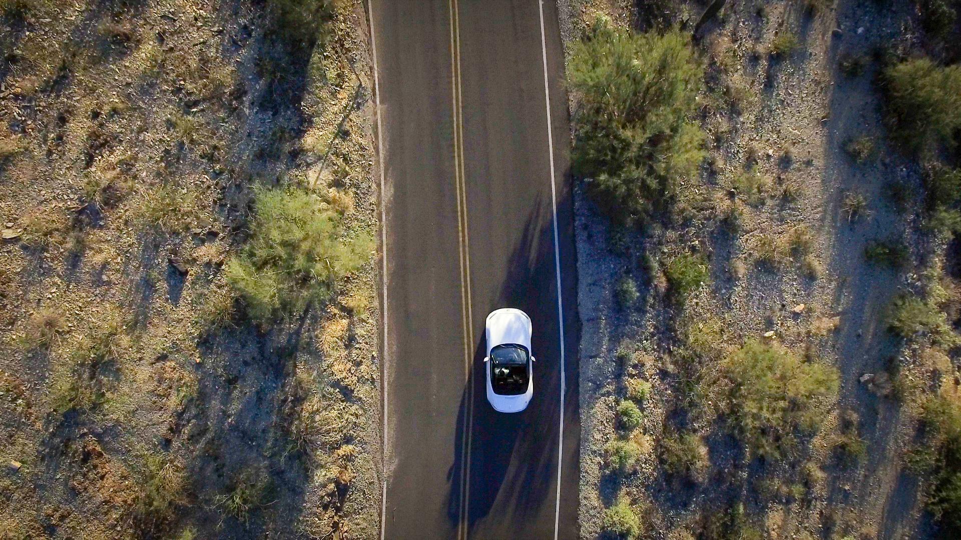 Arial photo of a car driving through the desert in Arizona