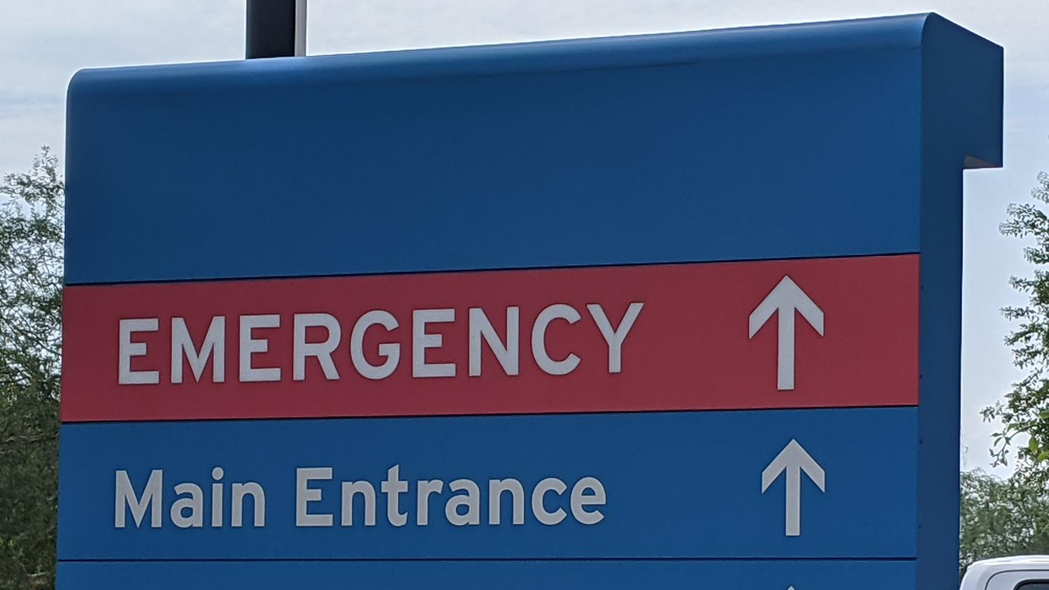 A sign pointing to the emergency department at an Arizona hospital