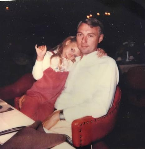 girl sitting on dad