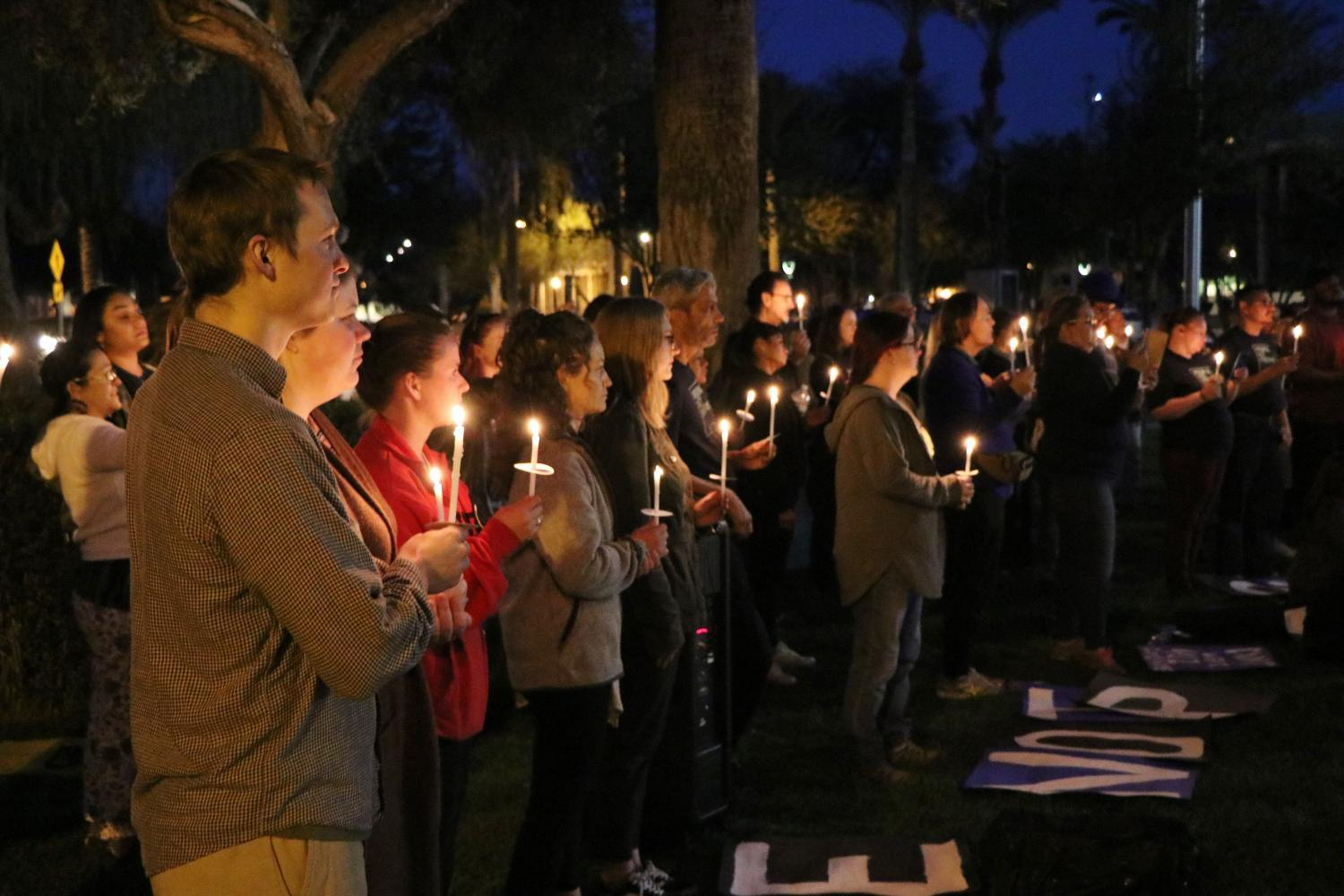 Supporters hold a vigil at the Statehouse
