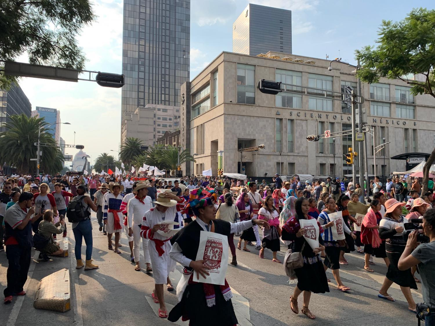Thousands marched in  downtown Mexico City on Thursday to commemorate the disappearance of 43 college students who were traveling by bus in the southern state of Guerrero.