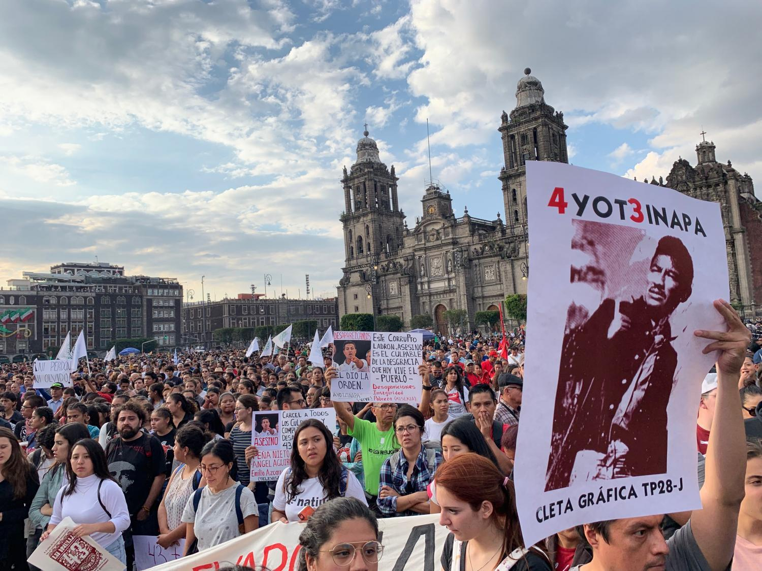 Thousands marched on Mexico City's central square on September 26, demanding answers into the investigation of 43 college students who vanished from the southern state of Guerrero