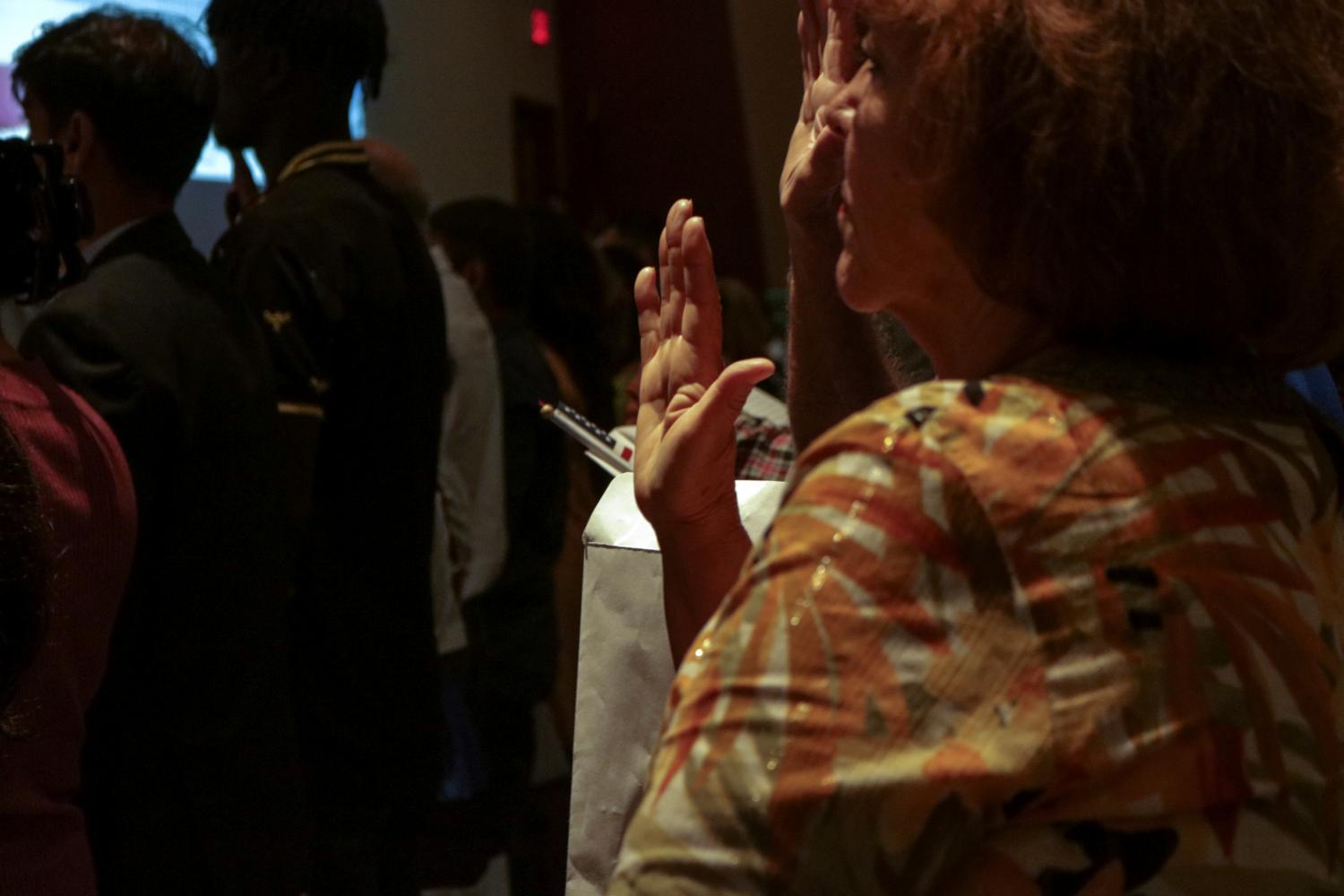 A new citizen takes the Oath of Allegiance