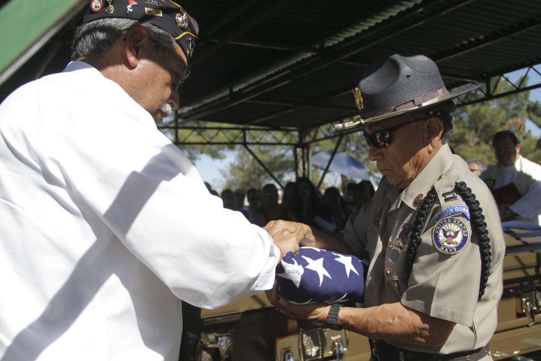 Santa-Cruz and Villalobos finish folding the flag