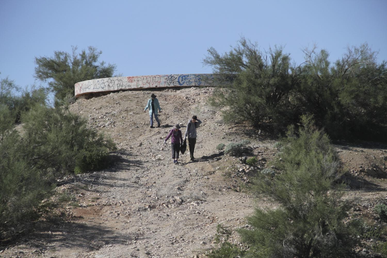 Nilson Wahl, Norma Yokota and Kathleen Wahl walk through the desert