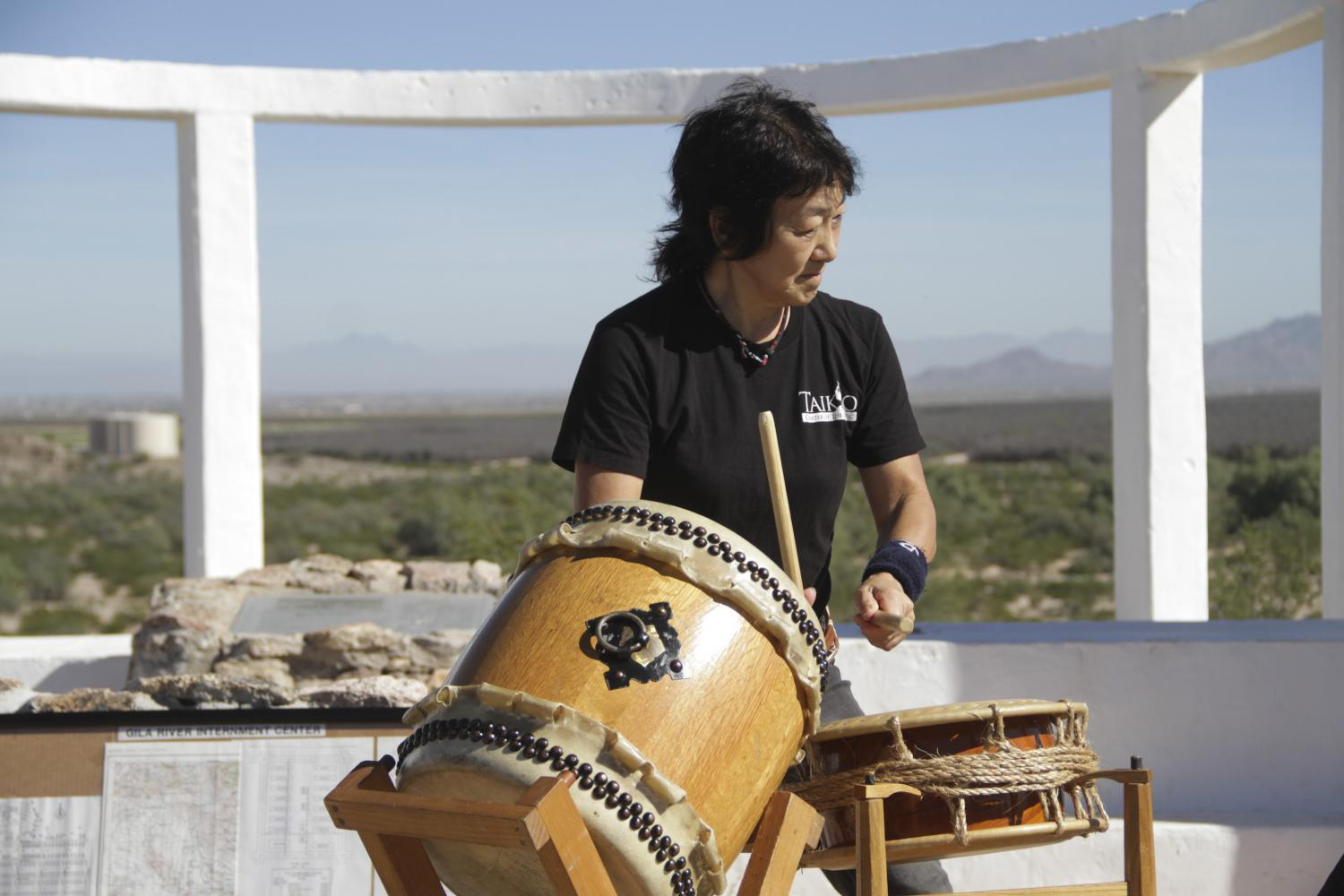Chizuko Endo plays in a Taiko drum group