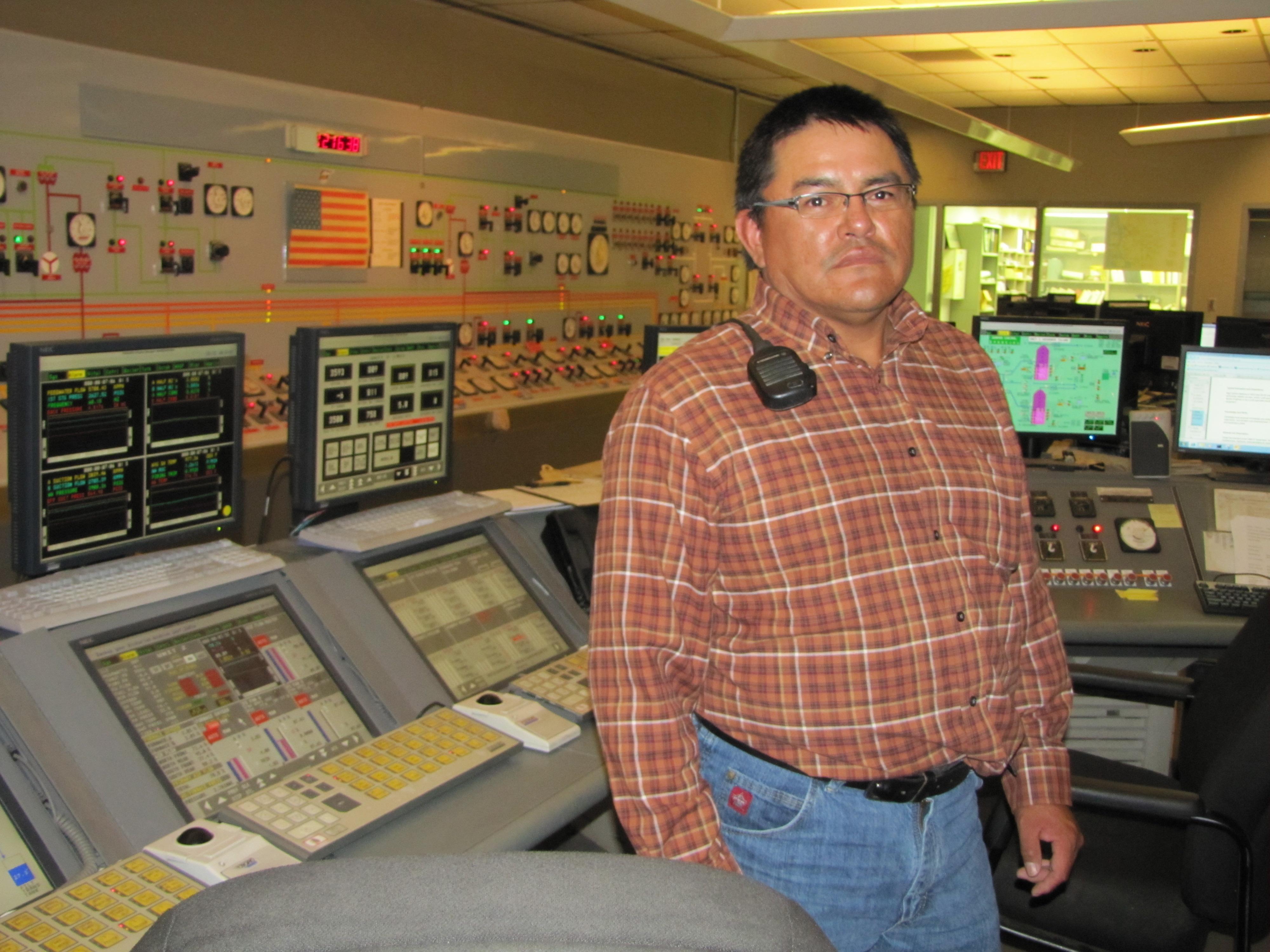 Julius Fat at his job as a control operator at the Navajo Generating Station.