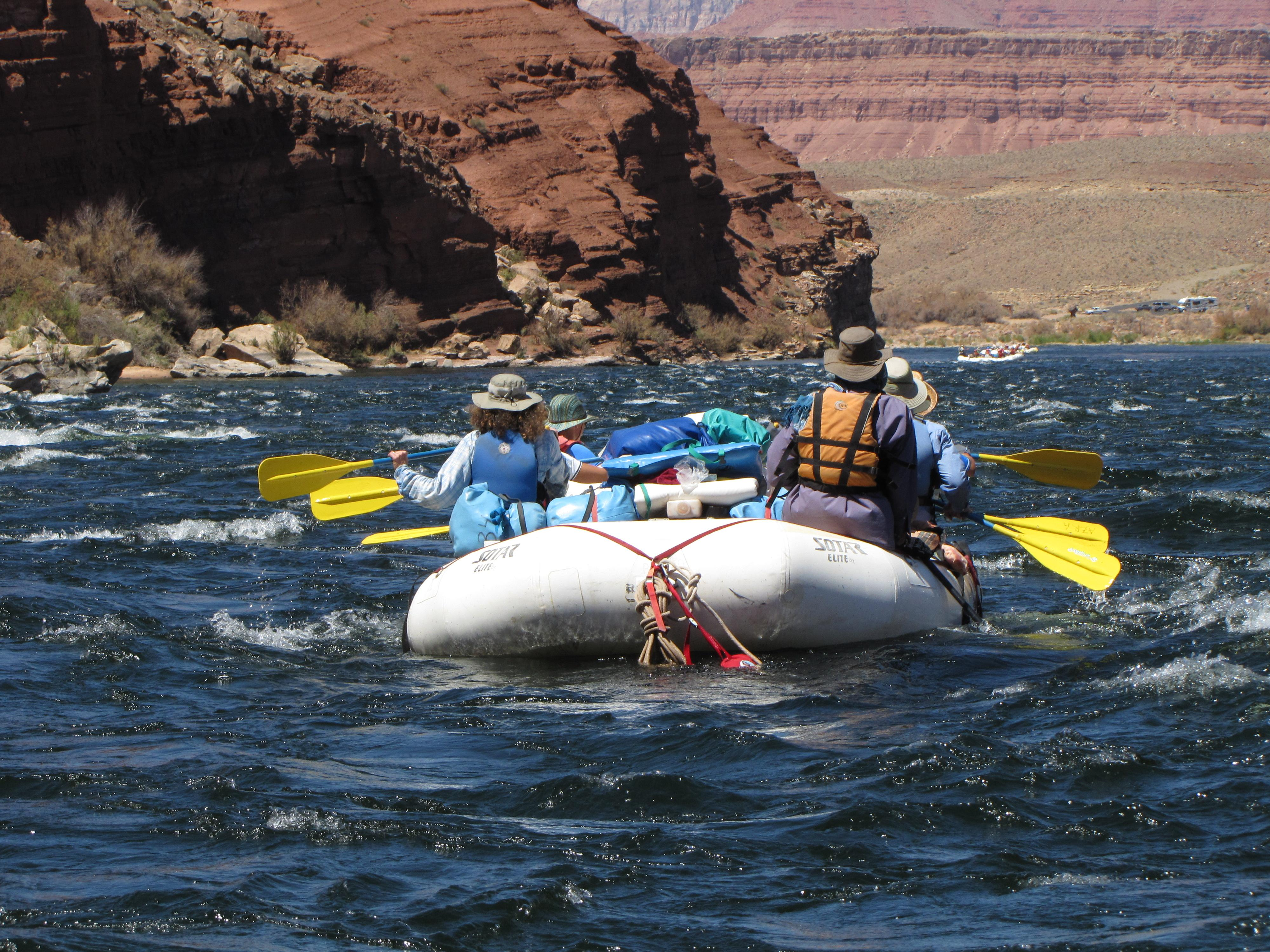 A group of paddlers prepare for their first rapid.