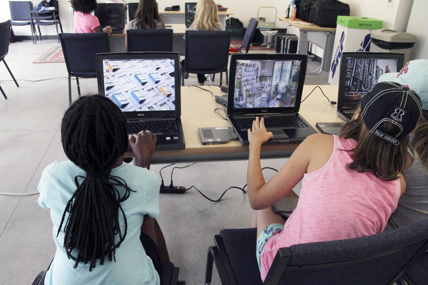 girls at a Girl Scout summer camp learn about computers
