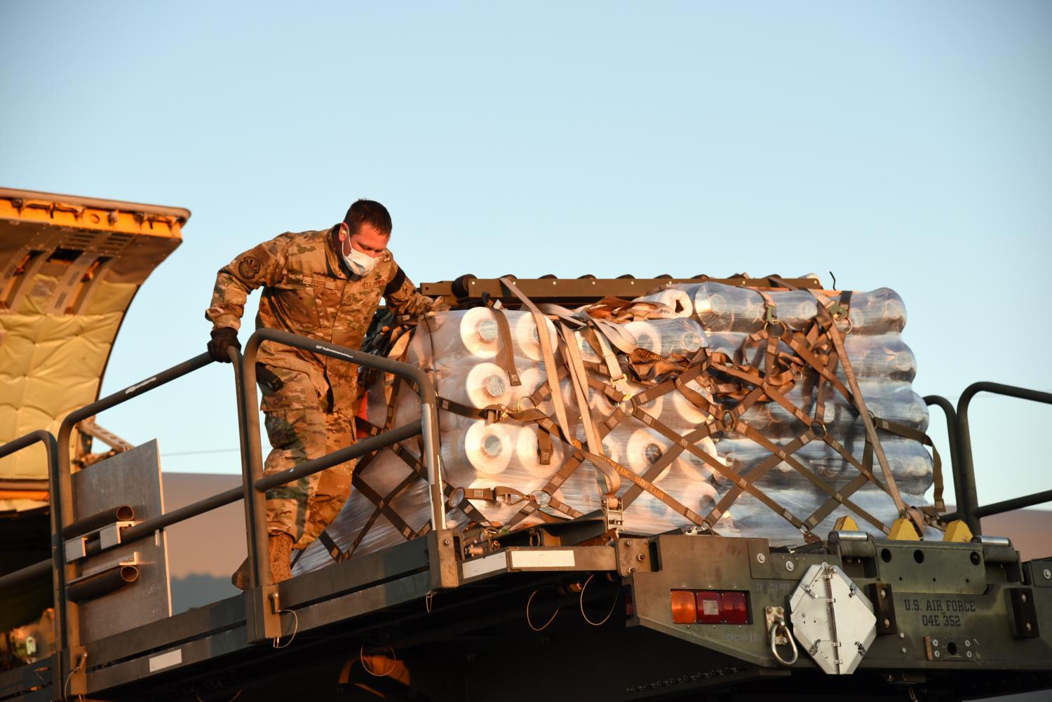 Loading PPE into an Arizona Air National Guard tanker jet.