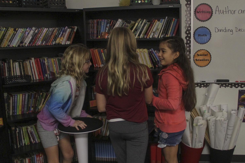 kids crowd the bookshelves