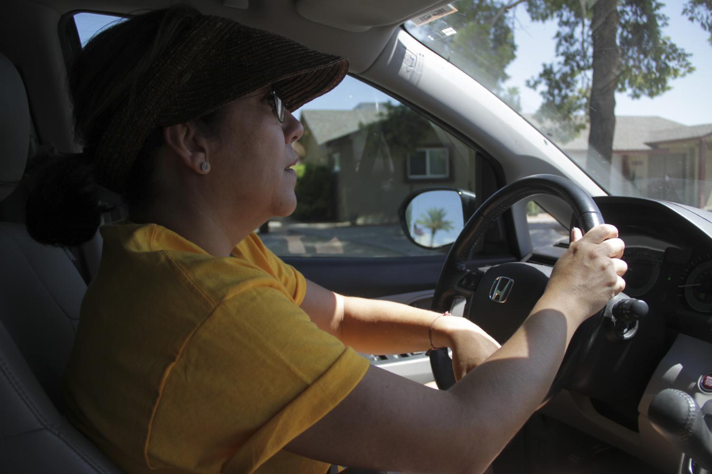 Raquel Mamani drivers her minivan
