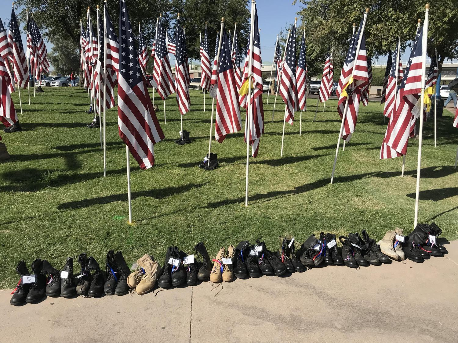Flags displayed at Tempe Healing Field for 9/11 memorial with an accompanying pair of boots.