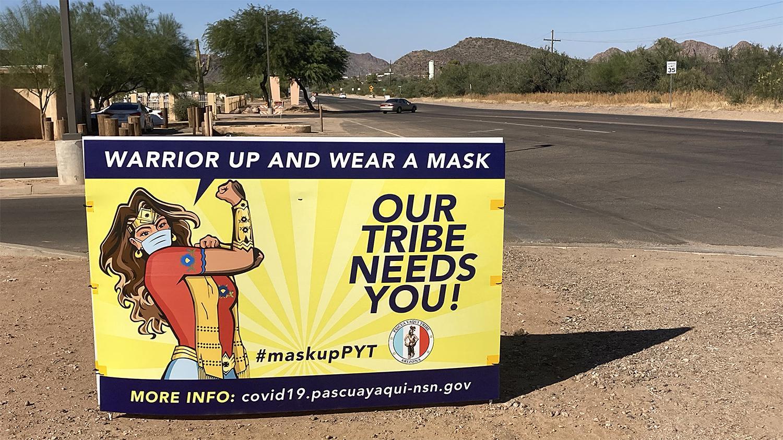 Pascua Yaqui vote mask sign