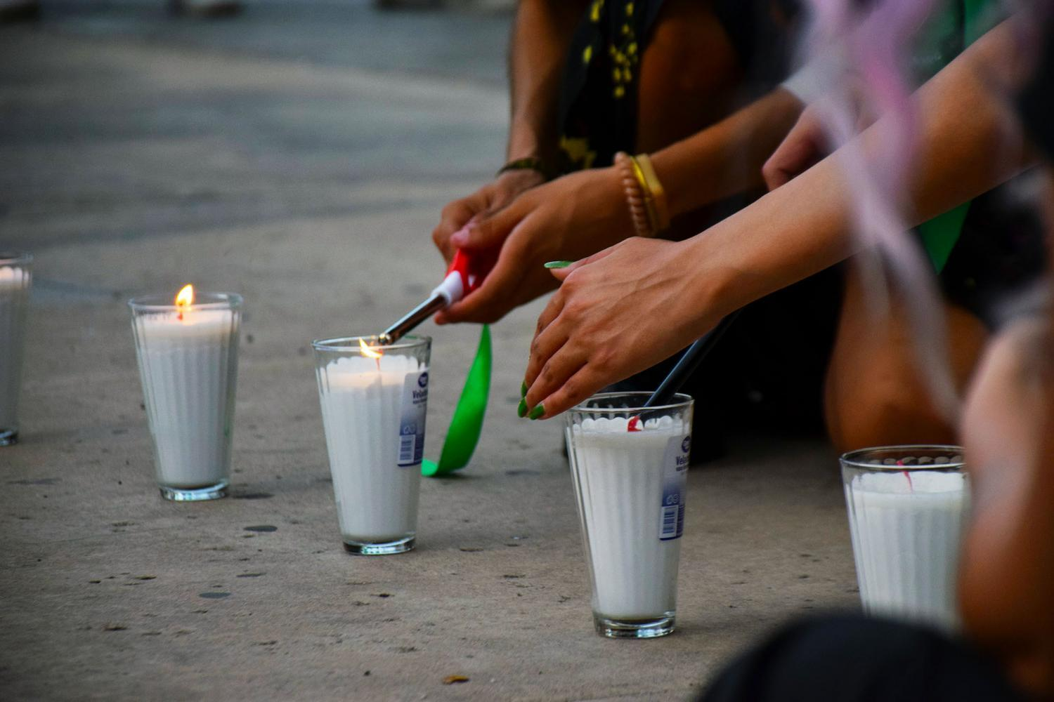 Protesters light candles
