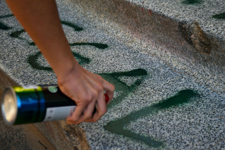 Protestors spray paint
