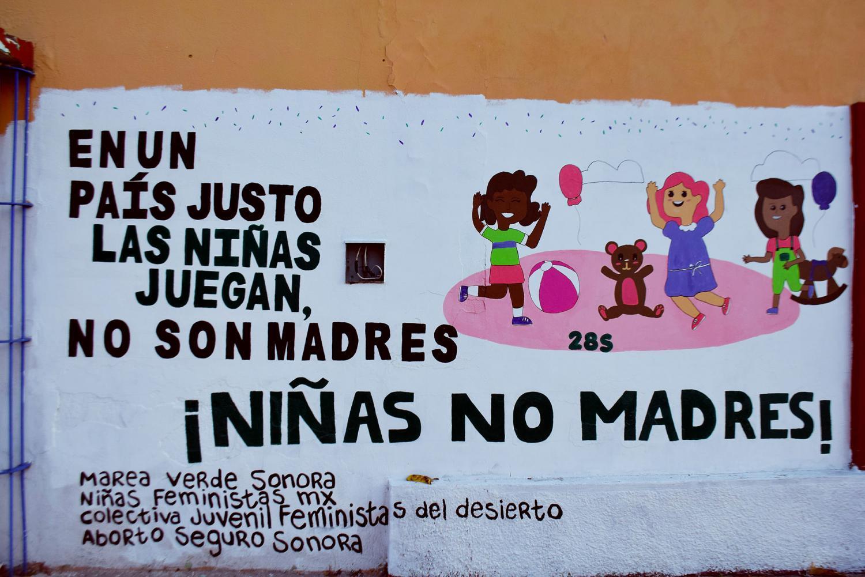 Girls not mothers mural