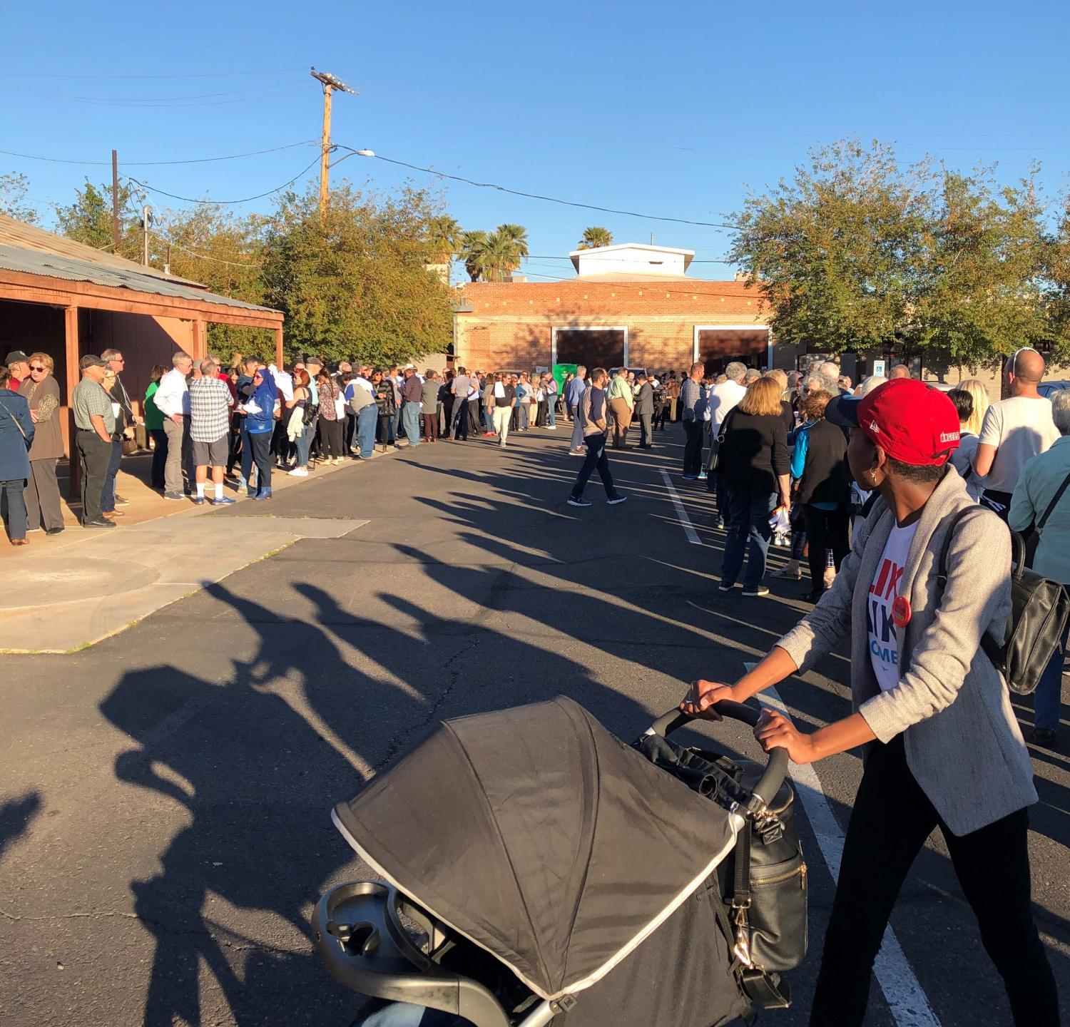 People line up outside a downtown Phoenix warehouse to hear Democratic presidential candidate Michael Bloomberg speak, Feb. 1, 2020.