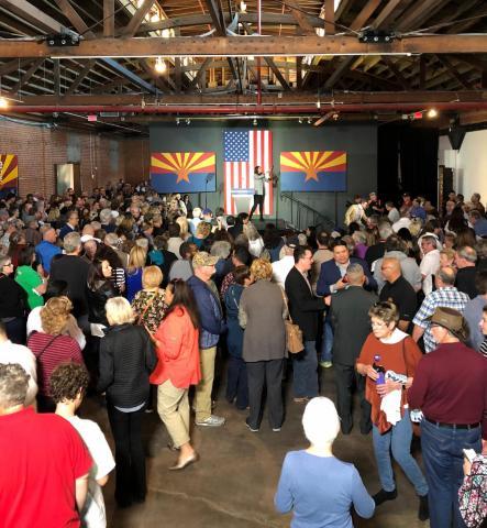 Spectators gather inside a downtown Phoenix warehouse to hear Democratic presidential candidate Michael Bloomberg speak, Feb. 1, 2020.