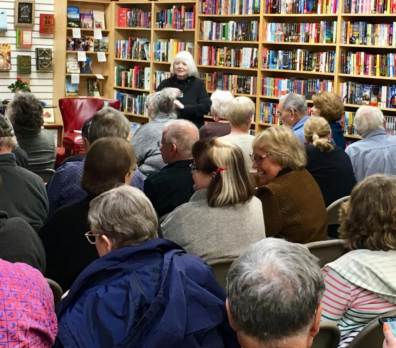 audience listens to author