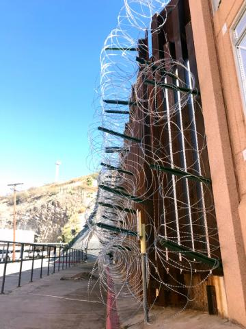 concertina wire on the border fence in Nogales, Arizona