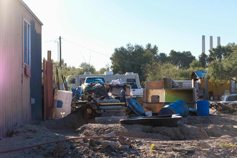 homes in Rillito, Arizona, are adjacent to piles of trash