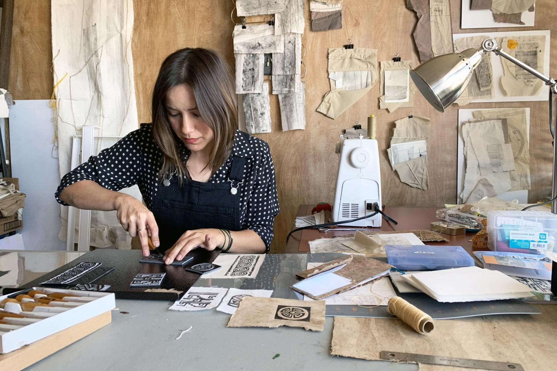 Diana Calderon carves designs into linoleum